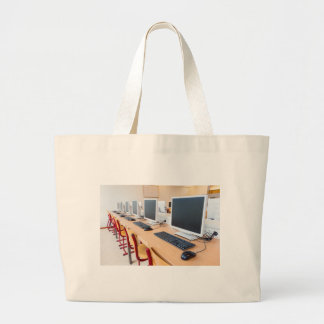 Computers in classroom on high school large tote bag