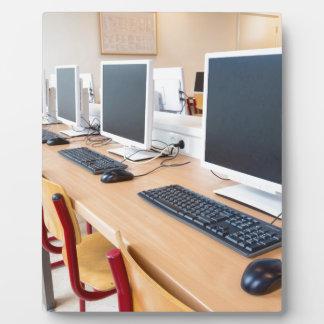 Computers in classroom on high school plaque