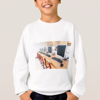 Computers in classroom on high school sweatshirt