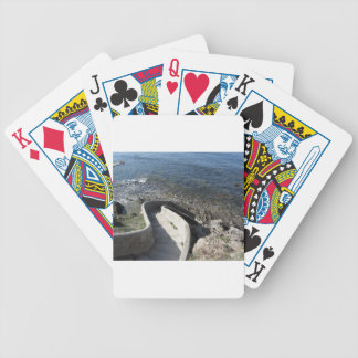 Concrete staircase down to the sea . Spiral stairs Bicycle Playing Cards