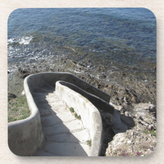 Concrete staircase down to the sea . Spiral stairs Coaster