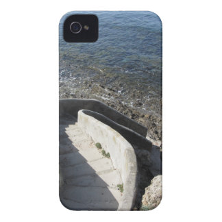 Concrete staircase down to the sea . Spiral stairs iPhone 4 Cover