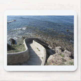 Concrete staircase down to the sea . Spiral stairs Mouse Pad
