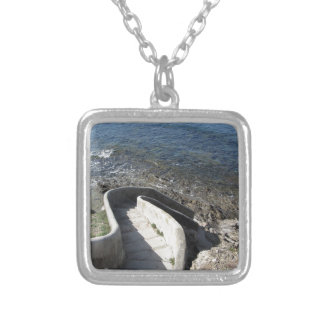 Concrete staircase down to the sea . Spiral stairs Silver Plated Necklace