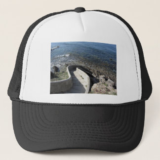 Concrete staircase down to the sea . Spiral stairs Trucker Hat