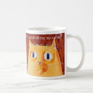 Confrontational orange cat with round eyes coffee mug