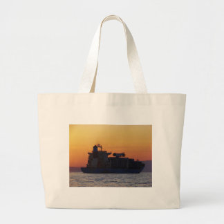 Container ship at sunset bags