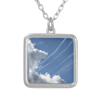 Contrails of aircraft and clouds in the sky silver plated necklace