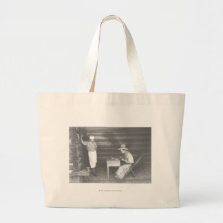 Cook watching a cowboy play cards 2 large tote bag