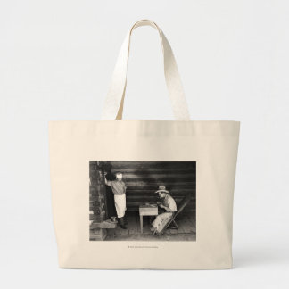 Cook watching a cowboy play cards large tote bag