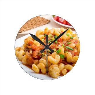 Cooked pasta cavatappi closeup round clock