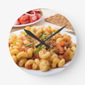 Cooked pasta cavatappi with stewed vegetable sauce round clock