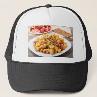 Cooked pasta cavatappi with stewed vegetable sauce trucker hat
