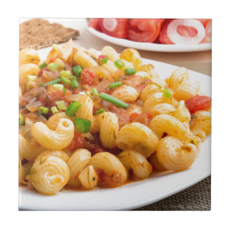 Cooked pasta cavatappi with vegetables sauce ceramic tile