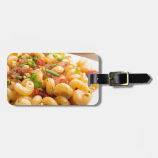 Cooked pasta cavatappi with vegetables sauce luggage tag