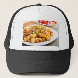 Cooked pasta cavatappi with vegetables sauce trucker hat