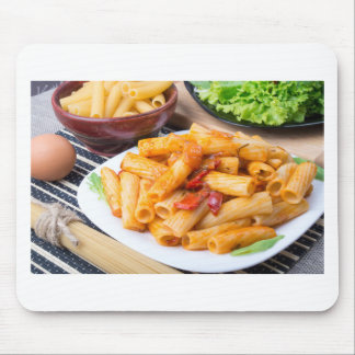 Cooked rigatoni pasta, seasoned with pepper mouse pad