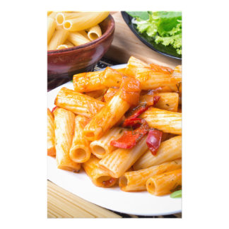 Cooked rigatoni pasta, seasoned with pepper stationery