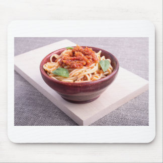 Cooked spaghetti in a brown small wooden bowl mouse pad