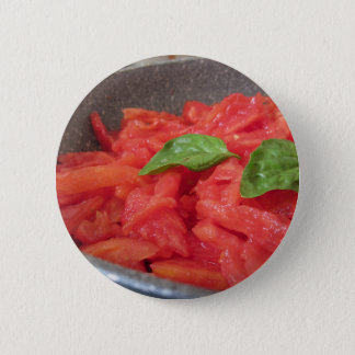 Cooking homemade tomato sauce using fresh summer t 6 cm round badge