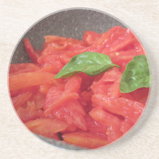 Cooking homemade tomato sauce using fresh summer t coaster