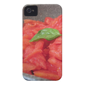 Cooking homemade tomato sauce using fresh summer t iPhone 4 case