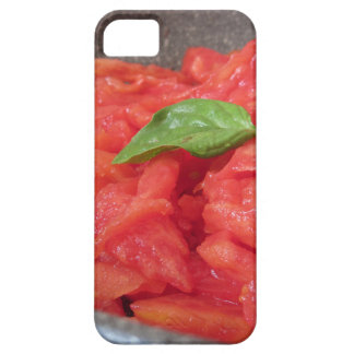 Cooking homemade tomato sauce using fresh summer t iPhone 5 cover