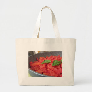 Cooking homemade tomato sauce using fresh summer t large tote bag