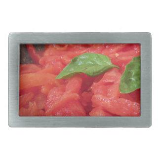 Cooking homemade tomato sauce using fresh summer t rectangular belt buckle