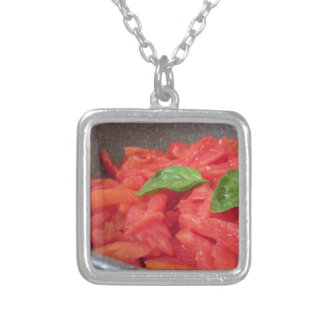 Cooking homemade tomato sauce using fresh summer t silver plated necklace