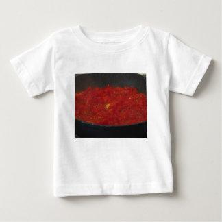 Cooking homemade tomato sauce using fresh tomatoes baby T-Shirt
