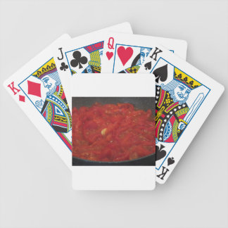 Cooking homemade tomato sauce using fresh tomatoes bicycle playing cards