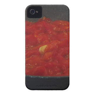 Cooking homemade tomato sauce using fresh tomatoes iPhone 4 cover