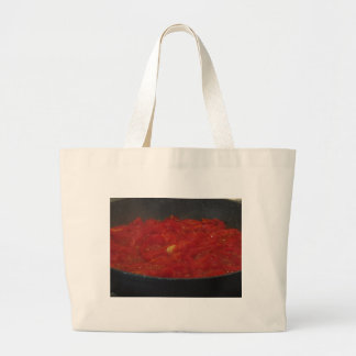 Cooking homemade tomato sauce using fresh tomatoes large tote bag