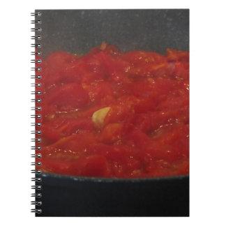 Cooking homemade tomato sauce using fresh tomatoes notebook