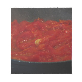 Cooking homemade tomato sauce using fresh tomatoes notepad