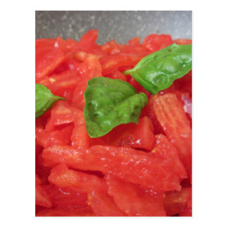 Cooking homemade tomato sauce using fresh tomatoes postcard
