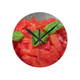 Cooking homemade tomato sauce using fresh tomatoes round clock