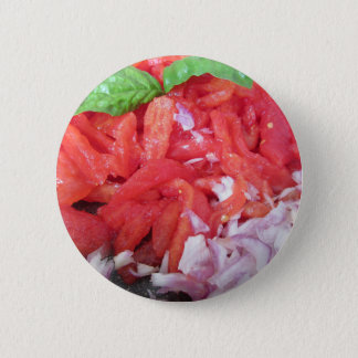 Cooking homemade tomato sauce using tomatoes 6 cm round badge