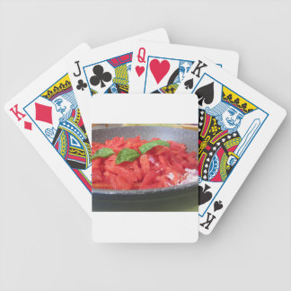 Cooking homemade tomato sauce using tomatoes bicycle playing cards