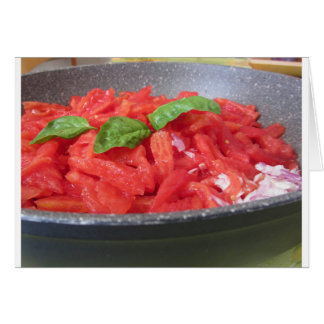 Cooking homemade tomato sauce using tomatoes card