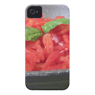 Cooking homemade tomato sauce using tomatoes iPhone 4 cover