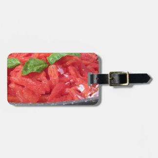 Cooking homemade tomato sauce using tomatoes luggage tag