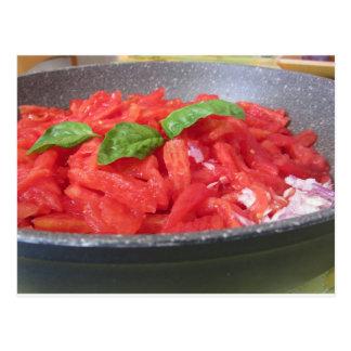 Cooking homemade tomato sauce using tomatoes postcard
