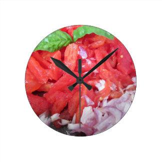 Cooking homemade tomato sauce using tomatoes round clock