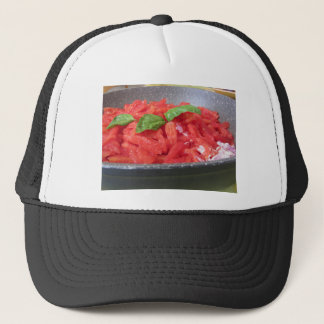 Cooking homemade tomato sauce using tomatoes trucker hat