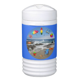 Cooler beach, ocean surrounded by beach items