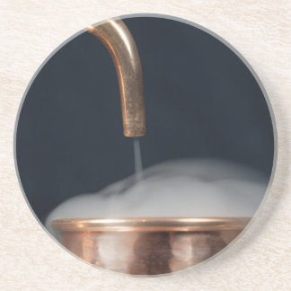 copper pipe of a distillery with steam. coaster