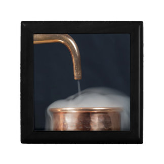 copper pipe of a distillery with steam. gift box