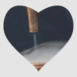 copper pipe of a distillery with steam. heart sticker